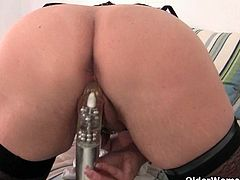 Dressed sexy, Abigale lays in her bed and has a bit of fun with her fingers and then with her vibrator.