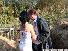 Beauty And The Senior sex clip provides you with a hot and voracious brunette nympho. This slender girlie meets an old fat man on the hayloft. Girlie in white dress bows above his dick and sucks old but still strong cock passionately for sperm.