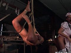 Rapacious nurse takes part in BDSM sex scene where she hangs a playful brunette hussy in the air before she makes her tongue fuck her shaved cunt and later fists her soaking twat in lesbian sex video by 21 Sextury.