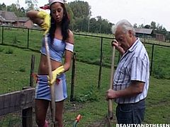 There's nothing to do in the village. That's why tall long legged brunette with small tits has a kinky hobby. This whore seduces a gaffer to give him a solid blowjob for sperm right near the hut.
