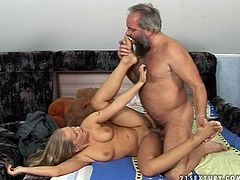 Skanky blond chic makes out with aroused grey haired dad. He eats her soaking cunt with pleasure before she gets drilled missionary style until he ejaculates abundantly on her belly.