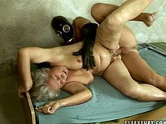 Fat ass granny with big saggy boobs is sitting on a sex machine having her cunt filled with sex toy. While the device is working hard in her clam, brutish dude in mask mouth fucks horny granny. Later he pounds her poontang in a missionary position.