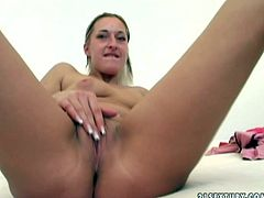 Skanky blonde girl with small perky tits and ugly face is fingering her hairy clam. Then she stands on her all four getting her coochie stretched wide by perverted dude. He is fisting her intensively.