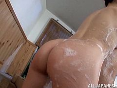 An old Asian dude is going to have the time of his life when a soaped up Japanese babe with hot ass gives him a blowjob in the tub.