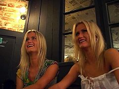 Appealing blonde girls are chilling with horny guy in the cafe. They start seducing him for FFM threesome. He thrusts his dick out of his pants getting awesome double blowjob.