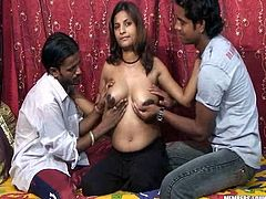 Two Indian guys play with huge boobs of one pregnant hoochie
