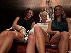 See how this guy gets to lick and suck many feet in this femdom video with three dominant sluts having fun with him.