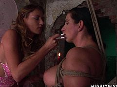 Stupid busty pregnant slut takes part in BDSM sex scene where she gets hanged to the ceiling bandaged before a pitiless domina starts burning her neck and nipples with a candle in perverse sex clip by 21 Sextury.