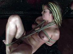 Perverse domina is a sophisticated nympho that ga-gas over BDSM sex. She bandages a steamy blond MILF before hanging her to the ceiling and plugs her mouth with a gag in perverse sex video by 21 Sextury.