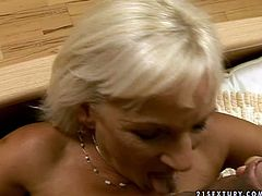 Voracious blonde granny is still hot sexpot. She gives hot titjob and footjob before getting her hairy cunt licked actively by horny bald guy. Then, she is nailed hard missionary style.