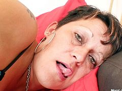 Hot tempered Czech whore likes it hotter and fucks her snatch with black toy. She keeps her legs wide open and thrusts fake cock deep in her slit.