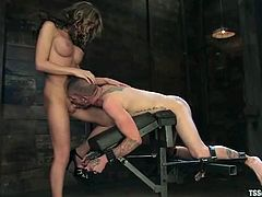 Sexy shemale Kelly Shore is having fun with Tristan Mathews in a basement. She chains the man and plays with his dick before smashing his ass with her prick.