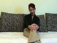 Naive looking brunette MILF sits on the couch in front of cam giving an interview before she takes off her clothes to sit with legs wide open to get her ruined punani drilled with massive end of baseball batt.