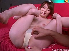 Charming Japanese chick Yui Nishikawa is having fun with some dude indoors. She moves her legs wide apart and allows the guy to finger her coochie and pound it with a dildo.