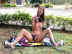 Busty Tania Spice enjoys fingering her twat in sexy outdoor solo session