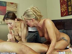 Big boob mom teaching her lovely daughter to suck stiff cock. Watch this mother and daughter tandem as they eagerly gags a large dong, see her mom lead the way and shows how stuff goes.