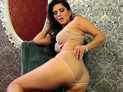Dazzling Sunny Leone is amazing while posing solo in her amazing lingerie