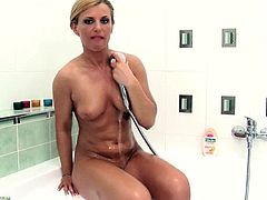 Join this fucking bitch in the shower for an amazing solo scene where the nude babe fondles her hot body and fingers her tight cunt.