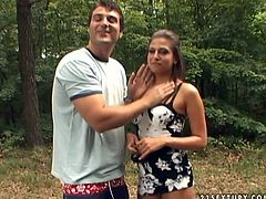 Brunette babe flashes her titties outdoor. Then she kneels down taking massive dick in her mouth. She pumps hard stick with her mouth lips performing outstanding blowjob skills.