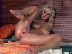 Some dirty-ass, big titty blonde bitch strips and oils up to perform a kinky solo scene. Hit play and check the whore out.