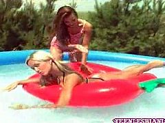 These hot teen chicks were frolicking in the pool when they ended up getting horny and splashing each other s cute bodies hoping for naked lesbian action.