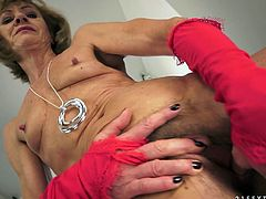 Kinky momma wearing sexy red lingerie fucks her pussy with fingers. She stretches her hairy snatch and shows you her deep pink vag. Later young dude finger fucks her ass hole.