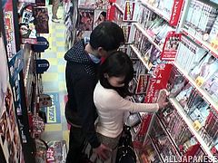 At the first sight, this Japanese girl doesn't seem to be that perverted. But she fucks in the DVD store with a strange dude.