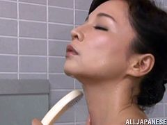 Japanese chick takes a shower. She soaps her body and then starts to fondle her pussy. Some guy opens the door insensibly and watches at this.