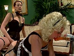 The crossdressed guy wearing a maid costume is going to be fucked by the naughty redhead Maitresse Madeline's strapon.