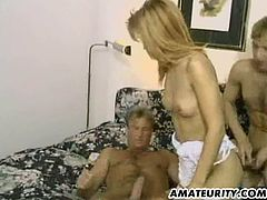 Lewd blonde whore double fucked in this fervent threesome pussy coition and she's giving everything she's got.