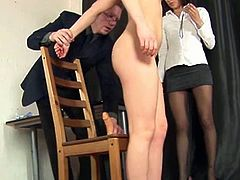 A man and a woman ask this cute brunette to totally undress and do what they say. She must masturbate and suck on dildos.