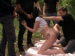 Doesn't she knows that is not safe to go out in the woods like that? Well too late for that because when Alina pulled off her short pants to take a piss so found herself surrounded by these horny men. They've grabbed her and in a matter of no time she was knelt and brutally mouth fucked. Stick around for more!
