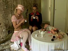 Playful blonde girl is wearing sweet costume looking adorable. Perverted mature woman goes nuts with her cuteness so she seduces her for sex. She suckles her tits and rubs wet panties.