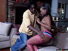 Well stacked Ebony hottie in original stripped bikini and raunchy pink fishnet stockings gets seduced by kinky black dude. He caresses her juicy ass before she squats down in front of him to give him a blowjob.