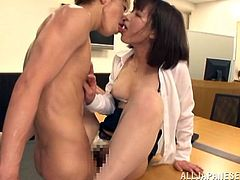 This sexy Japanese chick is called Mayu Kamiya and she's sucking cock and getting fucked with her clothes on in the office.