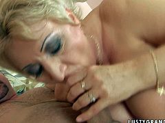 Spoiled mature woman gives her horny lover the hottest titjob of his life with those enormous tits of hers and then she takes his rigid dick for a long ride.