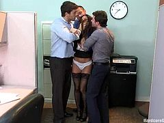 Kinky brunette girl gets bored at work, so she seduces her coworkers. She undresses and then sucks their dicks. Later on she gets her vagina and ass fucked rough.