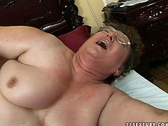 Fugly granny with bushy pussy is penetrated in her clam from behind. Young stud pushes big cock deep in her clam fucking her brains out. This old granny has never been fucked this good.