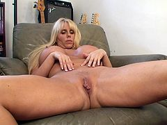 A busty whore gets naked, spreads her legs and fucking shoves a big-ass fucking dildo up her motherfucking cunt, hit play and check it out!