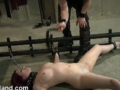 Submissive redhead babe enjoys bdsm