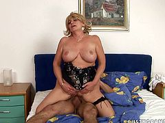 This mature harlot takes full control of her young lover's dick riding it passionately in reverse cowgirl position. Then she bends over for doggy style pounding.