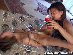Watch these two horny Japanese lesbians in bdsm bondage scene where this sex slave is tied up and made to suck and lick her mistress.Enjoy these hairy pussies in bondage action with lots of wax dripping scene over her sexy slim restrained body.