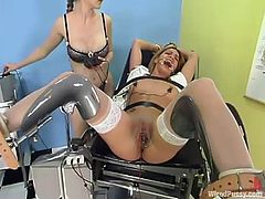 The gynecologist's patient is getting toyed and strapon fucked in this BDSM lesbian video by the very doctor in charge of examining her cunt.