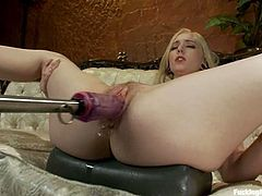 Sweet blonde chick with sexy legs lies on a sofa and gets her pink pussy stuffed by the fucking machine in close up scenes.