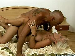Sexually aroused granny is getting banged hard from behind by bald guy that is half of her age. Then she gets on top of his rod jumping on it fast. Luckily she avoid heart attack on a set.