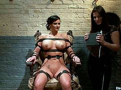 There's some wild action in store for Phoenix Marie, as the busty brunette gets tied to a chair by Bobbi Starr who has some kinky games planned.