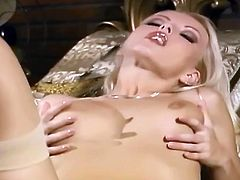 This classy blonde offers a really special strip show. She undresses slowly and reveals her magnificent intimate parts.