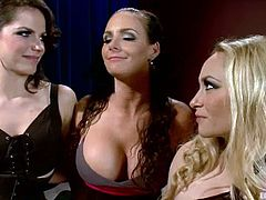 The busty Starrs, Aiden Starr and Bobbi Starr, are going to strapon fuck a girl in a lesbian threesome with kinky action.