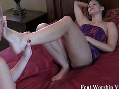 These naughty blonde and brunette bitches are ready to lick their sexy feet in this awesome vid. They also know how to use them to give their men amazing footjobs.