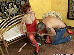 Ardent red-haired mature in passionate red lingerie and stockings rides a dildo machine with her ruined punani before she sits on the bench with tight spread wide allowing a perverse hubby poke her wrinkly snatch with dildo in sizzling hot sex video by 21 Sextury.